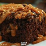 Enjoy Chocolate Turtle Poke Cake All Year Round